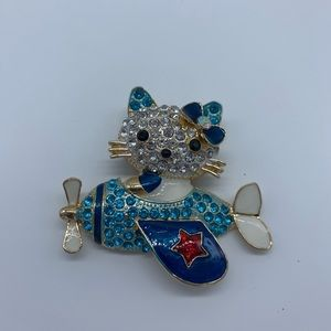 New blue kitty flying an airplane fashion brooch